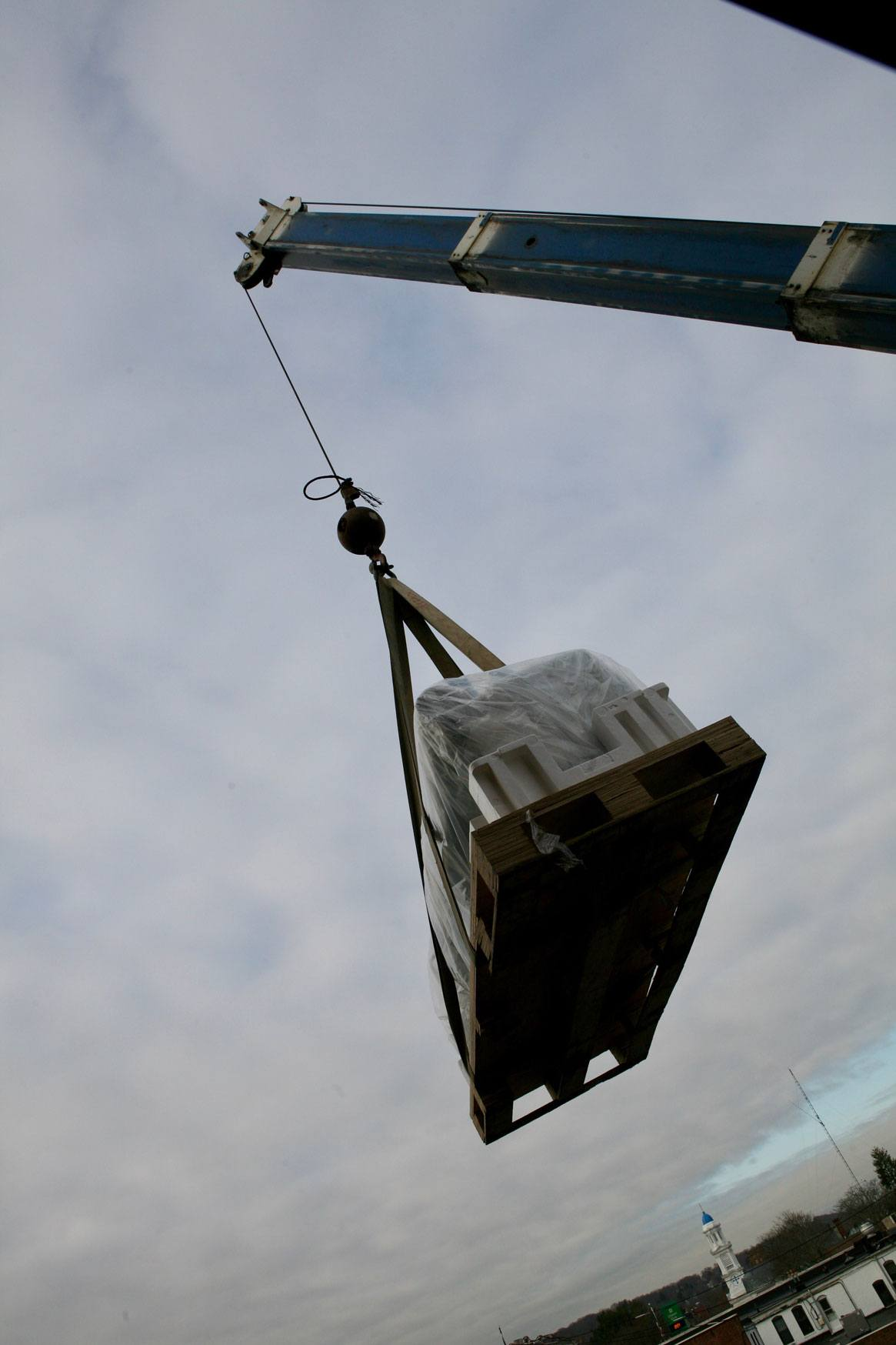 Epson P20000 printer hoisted in the sky by a crane