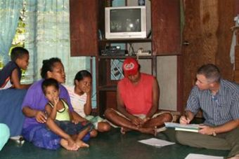 Air Force photo - Mark Duffy interviews family on Yap Island investigaing Zika outbreak